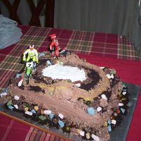 Dirt Bike Cake  made for grandsons 11th birthday where the white part is i filled it in with blue for water [ camera not working right now or would replace...