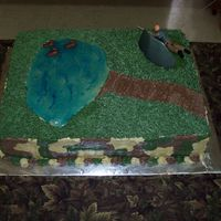 Groom's Hunting Cake Hunter behind a blind, ducks in the pond and camouflage on the sides
