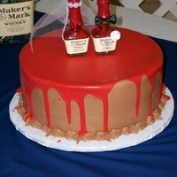 Maker's Mark Groom Cake Iced in chocolate BC icing with red ganche poured over top!