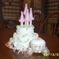 Princess Castle for dh's co-workers daughters birthday...marble cakes, sugar cones on top of hollow dowels rolled in edible glitter. Hope she likes it...