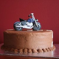 Motorcycle Cake Molded gumpaste motorcycle for a friends BF. Thanks to 2muchsugar for that photo as inspiration. Better than factory specs!