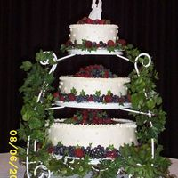 Wedding Cake-Emily & Raul bottom Italian Cream cake, med-brides white cake, top chocolate-surrounded with strawberries, blueberries and raspberries.