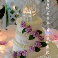 Wedding Cake For Michille And Phillip 3 different flavors, white chocolate icing-had to use photographers pictures-had to set up at site so couldn't use own camera!