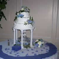 Kim's Wedding Cake Brides white-real flowers on top, sides and fountain silk-with baby's breath and ferns.
