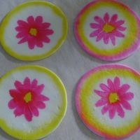 Cookie Flowers   Cut out cookies covered with fondant and rubber stampped flower with air brush color, air brushed sides