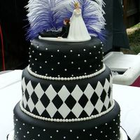 Black White Wedding   Wedding cake for a 1920's Gangster Style wedding. Cake covered with Black Fondant, Candy pearls, White fondant diamonds.