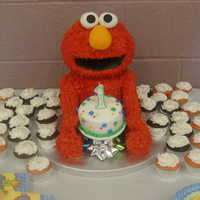 Elmo Elmo Cake - Head and body are cake; arms and legs are RKT all covered with grass tip in buttercream; fondant mouth, eyes and nose. Thanks...