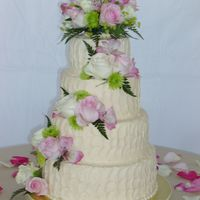 Stucco Look Wedding Cake   Stucco Look buttercream icing, real flowers, ivory