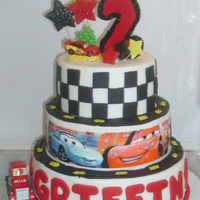 Cars   Disney Cars - buttercream icing with fondant accents; edible image in center layer.