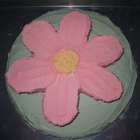 "Flower Cake It actually is the christening cake I made for my niece. A carved flower on a 14"". Yellow cake with all butter BC."