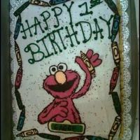 Elmo Birthday Cake   Carrot cake, with cream cheese frosting. Elmo, and crayons done in chocolate.