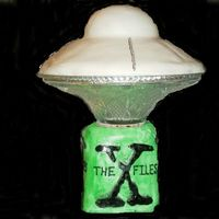 Xfiles Birthday Cake  The bottom is layered cake with fondant. The middle is a glass bowl with a flashing green light inside and the top is a fondant coverd cake...