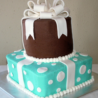 "Teal & Brown Presents Buttercream 6"" round and 8"" square. Fondant accents and fondant/gumpaste bow."