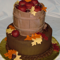 "Apple Basket Fondant ""basket"" cake on top with fondant apples and leaves."