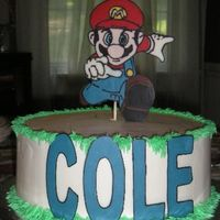 Mario Birthday Cake   White cake buttercream icing, Mario and COLE chocolate transfers