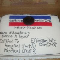 Medicare Cake This was a 1/2 sheet cake. Buttercream icing with red and blue fondant accents. It was for a Surpirse 65th Birthday party!