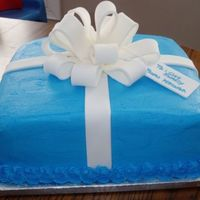 Baby Shower   Double layer 12 inch square with buttercream icing. Fondant bow and fondant gift tag!