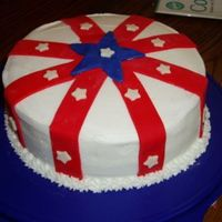 Memorial Day Cake  This is a double layer 8in round cake. Covered with BC icing and ble,red and white MMF accents. (My kids punched out the white stars for me...