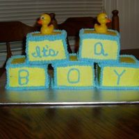 Blue_Ducky_Babyshower_Cake.jpg  I used a 4 inch square pan. Each block is a double layer. It took forever, as I only have one of those pans! uugg!!! But the end result was...