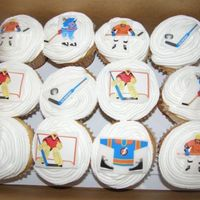 Hockey Cupcakes Jumbo cupcakes with buttercream icing. I used rolled white fondant and hockey stickers to top the cupcakes!