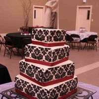 Dacus Wedding Designed according to the bride's wishes with cream cheese icing, damask done in black cream cheese icing and real ribbon. The tiers...