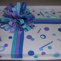 Purple Package WASC full sheet cake made for a monthly birthday party at a senior center. She wanted something new and modern and left everything else up...