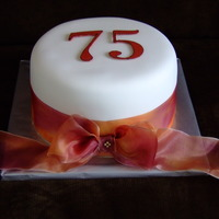 75Th Birthday Cake Fondant cake with ribbon. 75 is made out of chocolate