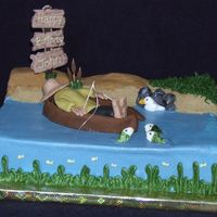 Fishing Cake Cake I made for my friend's husband. Was fun to make, man, boat and fish are out of fondant, sign is made from chocolate.