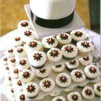 My First Wedding Cake! Wedding cupcakes and cake for a friends daughter's wedding. 120 cupcakes with fondant daisy toppers, small fondant covered WASC cake...