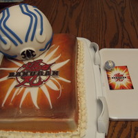 Bakugan Cake Cake I made for my son's 7th birthday. He is a bakugan nut! :) Beside the cake is the card and bakugan I tried to replicate. Bakugan...