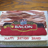 Bacon Cake My cousin was having a bacon birthday bash so I made this cake for her. Iced in buttercream, bacon is made of mmf and the bacon label is...