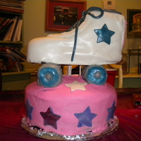 Roller Skate Cake Carved chocolate cake on wooden stand. RKT wheels all covered in MMF. First truly carved cake..ugh.