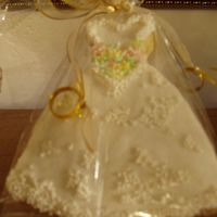 Wedding Dress Cookie Sugar cookie with buttercream designs. Glazed in melted buttercream.
