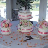Laurens Cake Round cakes with coral pink ribbon. The river rocks and colored gravel added a nice beach effect to the cake. The flavors were strawberry,...