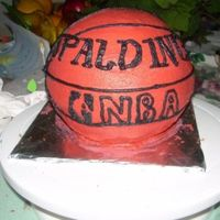 Basketball Cake   Cake is strawberry banana with BC icing. It goes with the basketball court I made.