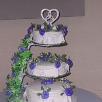 100_1769.jpg A Better picture of my best friend's wedding cake. It was beautiful :)
