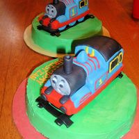 Thomas The Train This was my first attempts at 3D cake making. I used Debbie Browns cake photo as the inspiration. I have twins so I had to make two!