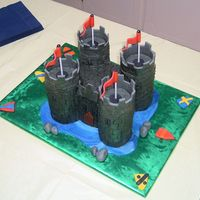"Castle This cake was inspired by Lindy Smith's from her book ""Storybook Cakes"". She did the whole caslte in fondant. I just did the..."