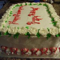 Holiday Party Cake My writing is terrible, but otherwise I like this one. The roses are dusted with clear glitter.