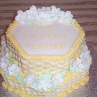 Yellow Basket Weave Cake Yellow and white basket of flowers
