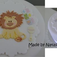 Baby Lion 6 inch fruit cake covered in fondX. Details are made from mexican paste using a patchwork cutter. Thanks for looking!