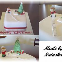 Natashachristmas.jpg 6inch fruitcake marzipanned and covered with FondX. My first time working with marzipan. Found it very difficult to use and so my cake...