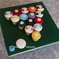 Pool Balls White chocolate cupcakes covered with fondant, inspired by several other cakes I've seen.