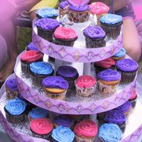 Disney Princesses Cupcake Tower Cupcake tower featuring the Disney Princesses including the ribbon around the cake boards and the cupcake papers.