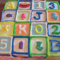 Baby Blocks Birthday A square slab first birthday cake modelled after baby building blocks. Letters refer to baby's initials; numbers are her birthday (5/...