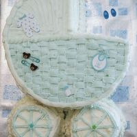 Its A Boy Baby Carriage this is a white cake with strawberries and a cream cheese mixture as the filling. buttercream frosting