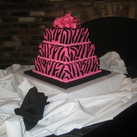 "Zebra Cake Fondant covered with fondant accents. Used a real zebra pattern to make the cake look more realistic, and not just ""striped"" like..."