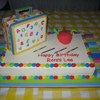 Off To School Cake This was for my cousin who was starting school shortly after her birthday. Lunchbox is cake covered in fondant, as well as the apple.