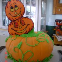 Pumpkin Patch Cake I made this for my dad's birthday. It's 2 bundt cakes with bc frosting. The stem (hard to see) was made from a heating core. The...
