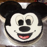 "Mickey Mouse 12"" White cake for head, 8"" Choc & Strawberry cake for the ears. Fondant for the ears and mouth. Did this for my own birthday..."